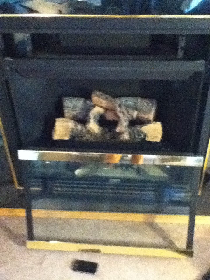 how to clean dust on fan on gas fireplace